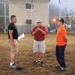 Before the start for A-Division Softball game, Chief Norman Bernard (left) of Wagmatcook passes the summer games torch to Chief Leroy Denny (right) of Eskasoni to continue the spirit of sportsmanship for the 2012 Mi'kmaq Summer Games in Eskasoni. MC Dion Denny (center) delegates the exchange. Chief Denny welcomed the challenge and looks forward to next year. Photo by George Paul