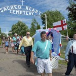 Kenny Prosper (Left), Alex Cope (Center) help carry St. Anne from the Millbrook cemetery.