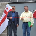 (L-R) Minister of Aboriginal Affairs and Northern Development, John Duncan cuts a ceremonial ribbon with Chief Norman Bernard of Wagmatcook offically opening the treatment facility.