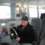 Jenna Marr of Indian Brook on the wheel of one of Canada's Navy ships.