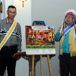 (L-R) Kji-Keptin Andrew Denny and Kji-Saqamaw Ben Sylliboy unvail the Mi'kmaq History Month Poster for 2012. The poster features Mi'kmaq Clan Names and the meanings of the names.