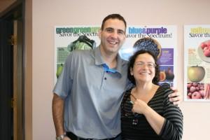 (L-R) Dr. Rob Todd congratulates Cheryl.