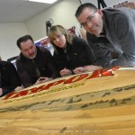 (L-R) Arcadia Consolidated School teacher Bruce Hobbs, vice-principal Larry Fitzgerald, Deanna Nauss of Natural Resources and Frank Grant of Yarmouth Recreation with a carved sign for the Tkipok Trail that was made by Mi'Kmaq carver Edwin Benham. Photo by Tina Comeau