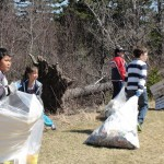 Students picking up garbage.