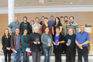 Presentation of the first ever Bras d'Or Lakes CEPI Golden awards, shown here are the two CEPI Coordinators and CEPI Chair Charlie Joe Dennis, with the winners, the Environmental Technology Class of students from NSCC Strait Campus (award held in photo by Kelly Murray) along with Pat Bates, Beverly Bryson of Ameoba Boat Tours, and Jim Foulds of the Biosphere Reserve Assoc.