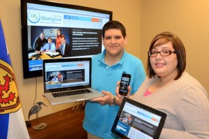 Shown trying out the new website on the iPhone, iPad and laptop are staff with the Unama'ki office for NSAEP, Tyler Gould and Pelonik Dennis, both Training Support and Job Coach officers.