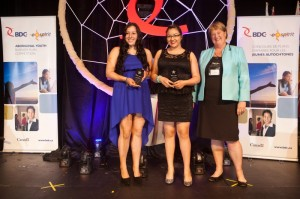 (L-R) Sydney Academy students Caroline Sylvester, and Jody Paul, pose for a photo with British Columbia Conservative MP Cathy McLeod at the Business Development Bank of Canada E-Spirit business plan competition for aboriginal youth in Kamloops, B.C., on May 16. Submitted by BDC.