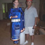 Miss Emily Sapier and her Grand-father, John Albert Sapier of South Carolina. Emily is shown wearing traditional Mi' kmaw dress, handmade by a Cousin in Nova Scotia for her talent event. She will also perform traditional dance with music.