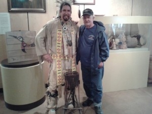 (L-R) General manager Jeff Ward of Membertou Heritage Park with John Boyd of Glace Bay, who donated this work of art which has graced his family for so long.