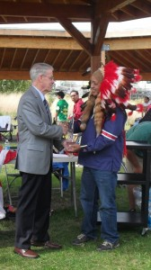 (L-R) His Honour JJ Grant handing Chief Gerard Julian the award. Photo by Susan Tapfer