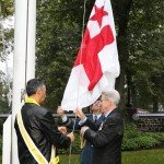 Kji Keptin Antle' Denny and his Honour JJ Grant, Lieutenant Governor of NS raise the Grand Council Flag at Government House. Photo courtesy of Communications NS.