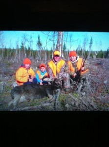 Potlotek youth pictured with moose.