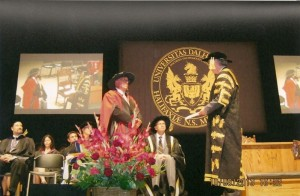 Dr. Daniel N. Paul (Left) receiving his Doctorate of Laws.