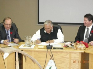 (Center) Chief Mi'sel Joe, of Miawpukek First Nation signing a Self-Government Agreement-in-Principle.