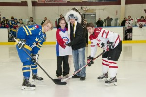 The respective captains of Team Sweden and Team Ontario officially faceoff with Eskasoni Chief, Leroy Denny along with Esso Canada Minor hockey player Erin Denny of Eskasoni. Photo by George Paul