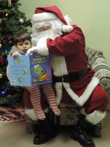 Baylen Brooks reads a story to Santa Claus. Photo by Lisa Paul