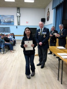 Trinity Stephens walks away with first place in the Remembrance Day poster contest at Truro Junior High School on February 27, 2014. The award was presented to her by the Royal Canadian Legion. Photo by Mark Stephens