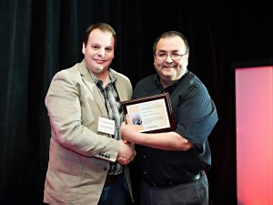 Sébastien Thibeault, Fisheries Coordinator, Maliseet of Viger First Nation, receives the 2013 Best Fishery Coordinator Award from John G. Paul, Executive Director, APCFNC.