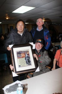 During the evening celebration Grand Chiefs Grand Children were presented with a special framed poster in recognition of the Grand Chief to be placed in the Gabriel center which was named in honour of the Grand Chief many years ago. In photo are some of Grand Chief Gabriel Sylliboy's grandchildren, from left Charles Sylliboy, Ben Sylliboy and sitting is George Sylliboy. Photo by Barry Bernard
