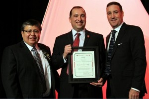 Mike McIntyre (Center) holding his AFOA award.
