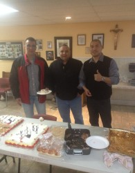 Trevor Sanipass (Right), making sure everybody gets some cake.