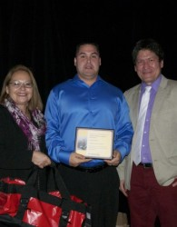 Sipekne'katik First Nation's Brandon Maloney receiving his award. On his left is Chief Matilda Ramjattan of Lennox Island First Nation and on Brandon's right is APCFNC's Director of Fisheries Ken Paul.