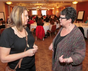 Cheryl Maloney, left, President of the Nova Scotia Native Women's Association and Community Services Minister Joanne Bernard chat during  the Nova Scotia Sexual Violence Strategy Mi'kmaq Community Engagement Gathering in Truro on Monday. Minister Bernard announced more than $150,000 in Prevention Innovation grants for Mi'kmaq organizations at the conference. Photo by Communications Nova Scotia