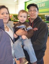Sherman Cremo and his girlfriend Rolanda Dennis were reunited with Josh MacDonald Monday, just a few days after the Eskasoni man came to the three-year-old's rescue as he choked on a raisin while on a family grocery shopping trip to the Sydney River Superstore. Cremo quickly applied the Heimlich manoeuvre and managed to dislodge the raisin from Josh's windpipe. Photo courtesy of the Cape Breton Post
