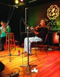 (L-R) Concert go-er Holly Sternberg of Reno, Nevada, joined Mooney Francis and Vincent Joe on stage to entertain the stranded Celtic Colours audience in Eskasoni after storms washed out roads on Monday. Photo by Cynthia Baughman