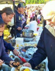 (L-R) Damaris and Eric Stevens serve up moose and side dishes to Elmer Capstick, and hundreds of others, at the annual moose feast in the Cape Breton Highlands. Photo by TOM AYERS / Local Xpress